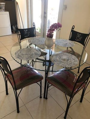Table Beautiful glass table with comfortable armchair that has space for voice, dining room and covered balcony. for Sale in Deerfield Beach, FL