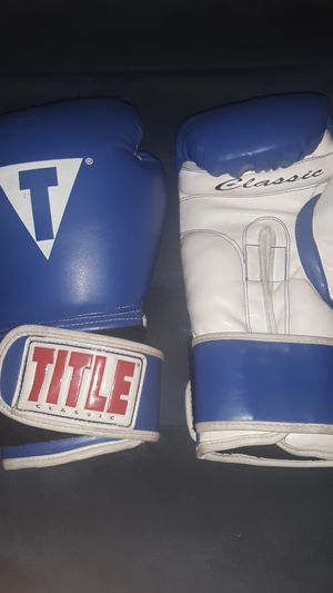 Title classic boxing gloves with tape for Sale in Modesto, CA