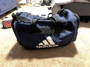 Huge new adidas bag filled with women's adidas and under armour clothes size med/large. for Sale in Vancouver, WA