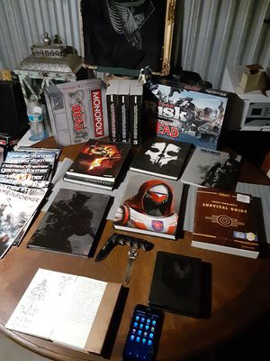 Gaming books and two board games for Sale in Denver, CO