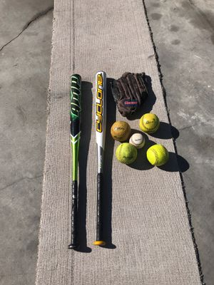 Two baseball bats, five base balls and one glove for Sale in Las Vegas, NV