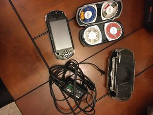 PSP model 1000, charger, PSP case, 6 games 1 movie, game disc holder for Sale in Corona, CA