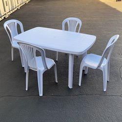 """$75 (new) lastic Table and (4pcs) Chair Set Outdoor Patio Furniture, Table 54x33x28"""", Chairs 17x19x34"""" for Sale in El Monte,  CA"""