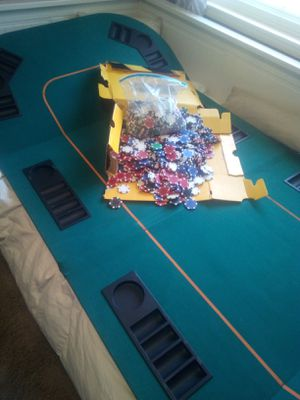 Very nice poker table.p with too many chips to count chips for Sale in Sacramento, CA