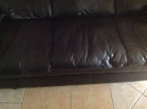 Free sofa in very good condition not broken just a little deteriorated no dogs inside the house for Sale in Clermont, FL