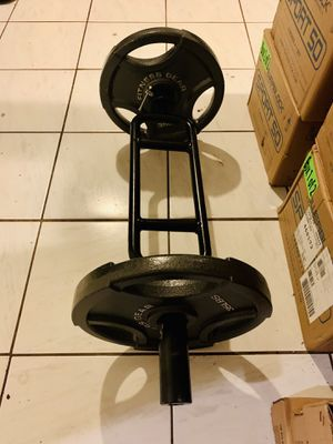 70 lb Olympic plates and tricep bar for Sale in Davie, FL