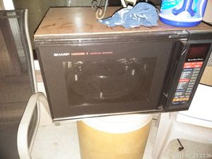 A sharp conventional microwave for Sale in Wichita, KS