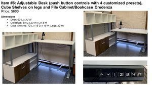 Adjustable desk (push button controls with 4 customized presets), cube shelves on legs and file cabinet/bookcase credenza for Sale in St. Charles, IL