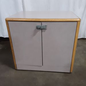 Oak cabinet on wheels with lock and key..good condition for Sale in Cleveland, OH