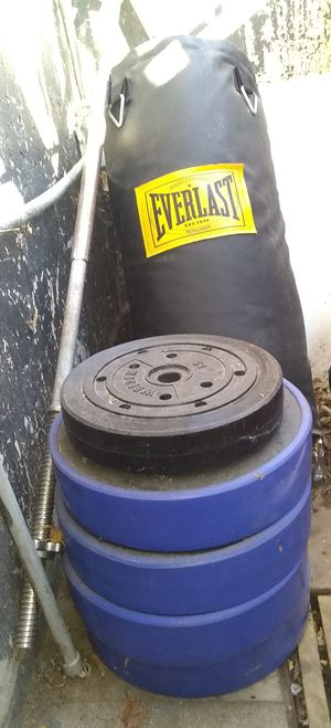Weights bar an Everlast punching bag for Sale in Westminster, CO