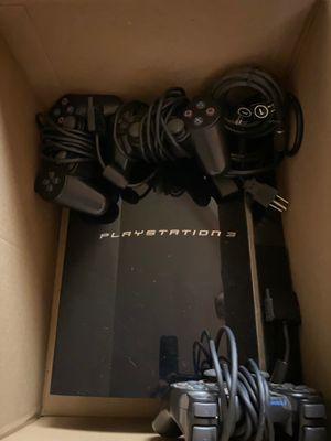 PlayStation 3 with steering wheel and games for Sale in El Cajon, CA