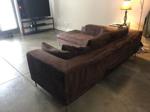 Metal frame brown micro fiber couch with ottoman that can be placed on either side for Sale in Mebane, NC