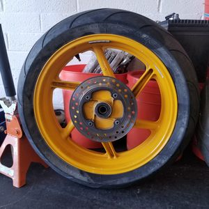 Cbr600f2 rear rim and tire with brake rotor for Sale in Phoenix, AZ