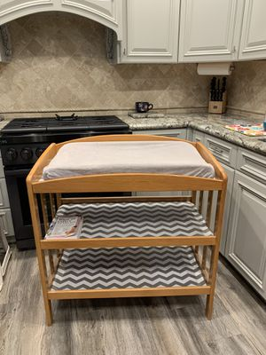 Three Tier Evenflo Baby Changing Table With Changing Pad, Ultra Soft Changing Pad Cover, And A What To Expect The First Year Baby Book for Sale in Los Alamitos, CA