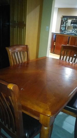 Dining room table and 4 chairs. Comes with extension leaf. for Sale in San Francisco, CA