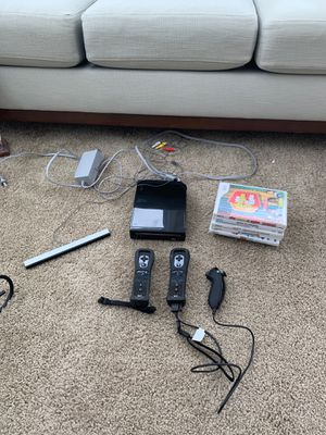 Nintendo Wii w/ controllers and joystick for Sale in Silver Spring, MD