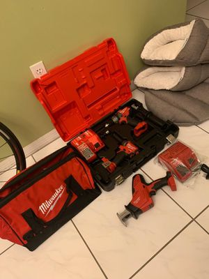 Milwaukee hammer drill and impact drill with sawzall for Sale in Miami, FL