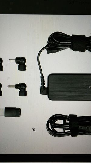 New Targus 65W Laptop Adapter Refurbished / Slim Line 5 tips included APA792USO for Sale in Ellenwood, GA