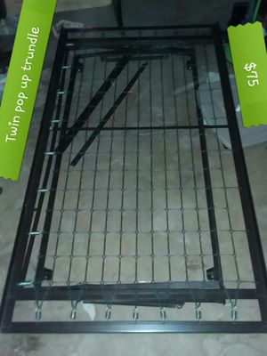 Twin pop up trundle bed frame for Sale in St. Louis, MO