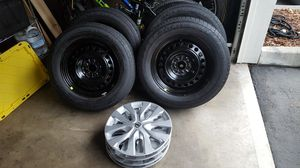 NICE Set of 4 tires from 2017 Nissan Rouge with hubcaps included! for Sale in Lynnwood, WA