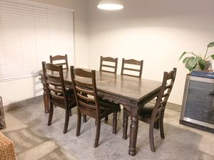 Large rectangular table solid wood rustic 6 chairs heavy dark brown carved world market pottery barn style for Sale in Chandler, AZ