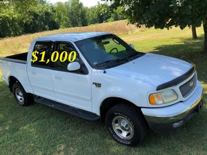 I'm seling $1,OOO URGENTLY 2OO2 Ford F-150 XLT Super Crew Cab 4-Door Runs and drives very smooth for Sale in Oakland, CA