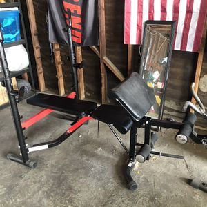 Body Champ Olympic Weight Bench with attachments included: Leg Developer, Preacher Curl Pad, Arm Curl Bar for Sale in West Covina, CA