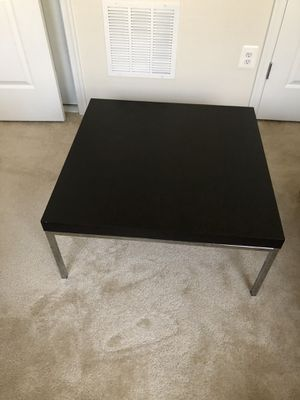 Black coffee table with metal base for Sale in Clarksburg, MD