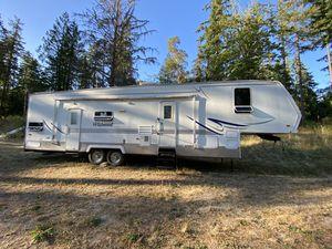 Wildwood Toy hauler fifth wheel trailer for Sale in Eatonville, WA