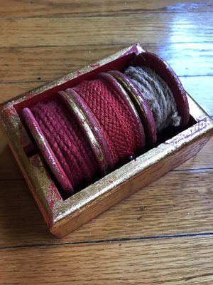 Burgundy Hemp Ribbon in A Stylish Gold and Red Reusable Box for Sale in Chicago, IL