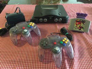 Nintendo 64 w Mario Party game 2 original clear purple controllers and cables for Sale in National City, CA