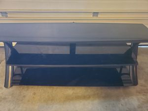 Black glass TV stand for Sale in Denver, CO