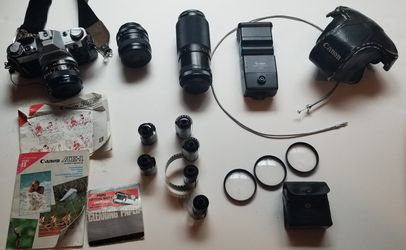 Canon AE1 camera, 3 lenses, flash unit, filters and film for Sale in Lakewood,  CO