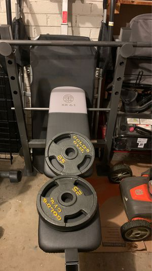 Gold's Gym XR 6.1 Weight Bench (Weight Bench) and Includes a 7' Olympic-style bar (3-piece assembly) and 2x 25-lb round, flat and cast iron plates for Sale in Alexandria, VA