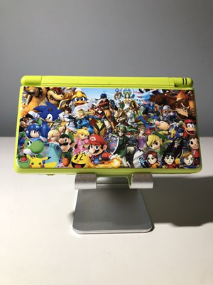 Nintendo DS Lite Super Smash Brothers Custom Skin and 150 Games included! for Sale in Willow Spring, NC
