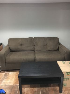 Brown couch and black coffee table for Sale in Philadelphia, PA