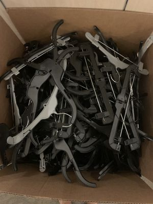 Box of black plastic hangers for Sale in Fresno, CA
