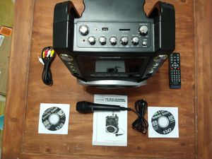 Complete Karaoke System with 1 Microphone, Remote Control, 7 Color Screen, LED Lights, and two sing along cd's for Sale in Mesa, AZ
