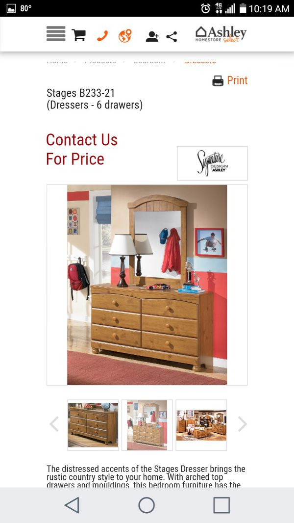 Dresser with mirror from Ashleys furniture