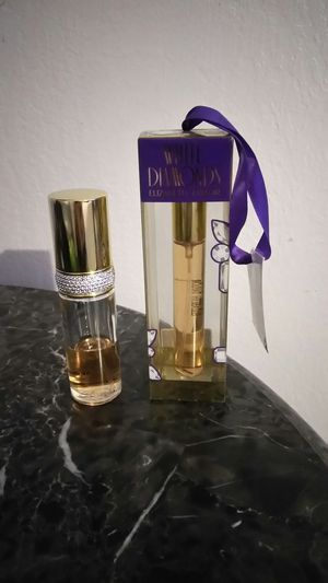 Brand new perfume throwing the other one free for Sale in Fresno, CA