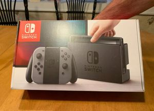 Nintendo Switch 32GB console with Gray Joy-Con and Pro Controller for Sale in Anchorville, MI