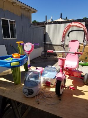 Assortment of kid's summer toys bike/scooter/water table humidifiers for Sale in El Cajon, CA