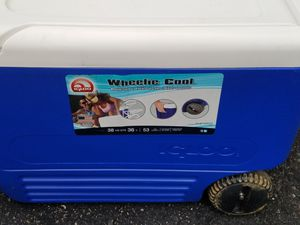 Igloo cooler with handle & wheels for Sale in Pittsburgh, PA