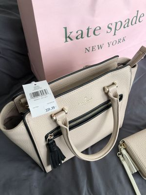 Brand new Kate Spade purse and wallet. The value is $540. It's new and never been used. Has tags and receipt. Willing to trade for Apple products or? for Sale in San Antonio, TX