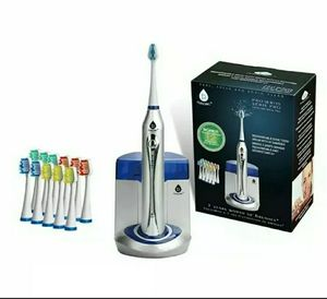 Pursonic deluxe sonic Toothbrush with 12 brush heads for Sale in Aurora, CO