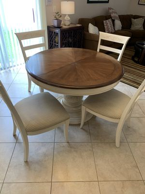 Round kitchen table with four chairs with extension table to fix six. Priced to sell. for Sale in Pompano Beach, FL