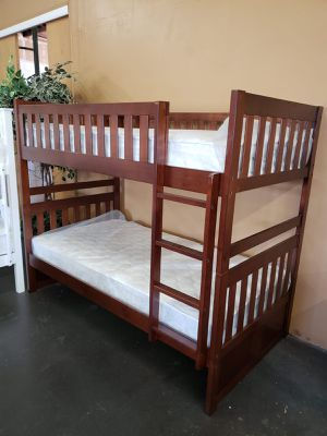 Solid wood twin size bunk bed with mattresses for Sale in Sacramento, CA