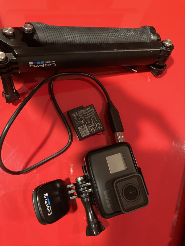 GoPro Hero 5 with extra battery, mount and case.