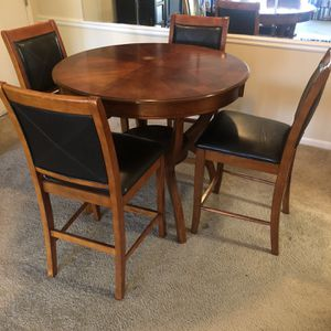 Free Bar Height dining table with 4 chairs with leather padding for Sale in Atlanta, GA