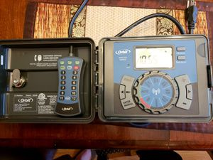 Orbit 12 zone sprinkler timer with outdoor box and remote for Sale in Wheat Ridge, CO